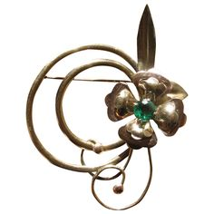 Vintage 1940's Harry Iskin Rhinestone Flower Brooch from Pam at Whimsical Vintage on Ruby Lane.  Love the way Iskin has the curling flower (stems?) wrapping around the circles. Lovely like a 40's corsage