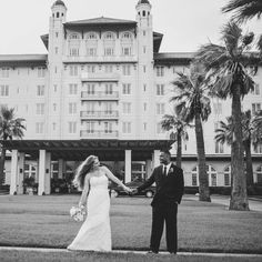 Loni and Keith posed in front of the historic Hotel Galvez Photo Credit: Civic Photos