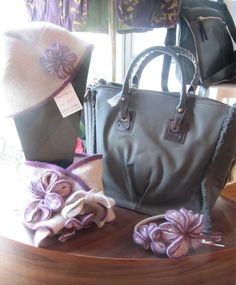 Linda Wilson hats and scarves, and Abbacino leather handbags.. Available in Gallery Crafts