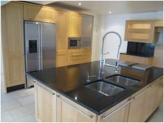 A used, designer bespoke kitchen with large island, granite worktops and Gaggenau/Miele appliances.     The kitchen is approx. 3 years old and in stunning condition - it has received very limited usage. £8999