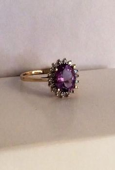 14K gold amethyst halo cut design ring with 18 diamonds. #williamsjewellerstoronto