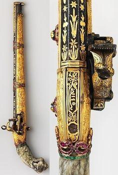 Ottoman miquelet pistol, ca. 1850 to 1875, lock dated 1145 A.H. / 1732 A.D., steel, nephrite, gold, emeralds, garnets, gold, L. 20 1/2 in. (52 cm); Cal. .62 in. (15 mm); Wt. 2 lb. 6 oz. (1077.2 g); L. of barrel 14 1/2 in. (36.9 cm), Met Museum.