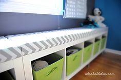 diy toy storage bench for nursery....pretty sure I'm going to do this for the baby's room as opposed to the 16 cube square bookcase Nolan has...
