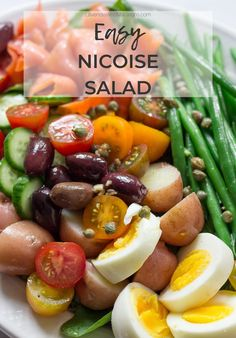 This Easy Nicoise Salad features crunchy green beans, smoked salmon, eggs, potatoes and zesty olives. All dressed in a simple olive oil anchovy vinaigrette. This healthy vegetable salad can be enjoyed for dinner or as a side dish for entertaining. Smoked Salmon Breakfast, Smoked Salmon Sandwich, Smoked Salmon Salad, Salmon Salad Recipes, Smoked Salmon Recipes, Easy Salad Recipes, Healthy Recipes, Easy Pasta Dinner Recipes, Night Dinner Recipes