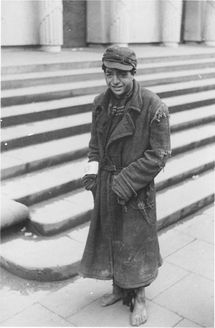Warsaw, Poland, A shoeless Jew in rags, 1941-1942.
