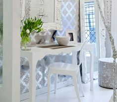 Layers of white and silver... ornate and modern.