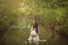 Beautiful outdoor maternity photo in water