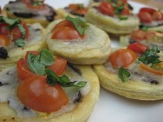 Tomato basil tartlets that Giada made on show. Great way to make puff pastry rounds that stay flat and crispy. Want to try this summer
