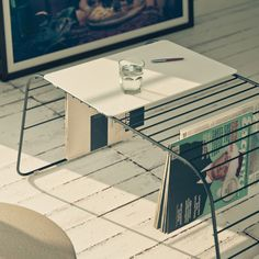 What a cool side table/magazine rack! Smart and nice to look at it!  I think we need one!