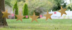 Are you looking to give your party a nice final touch!? This adorable banner will be a big hit :)  { Reasons- to- LOVE it} :  Your party will look fun and welcoming with a unique style. {The- Fabulous-DETAILS} :  The pink ribbon measures 7 feet long The 5 metallic gold stars are made from premium foil card stock 9 (backside is white) The 4 pink stars are also made from premium card stock 2.5 4 mini wooden clothespin {Good- to- know- INFO} :  Please keep your banner away from all heat sources…