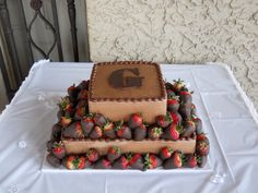 Two tier chocolate grooms cake with strawberries. - Two tier chocolate grooms cake with chocolate dipped strawberries and monogram.
