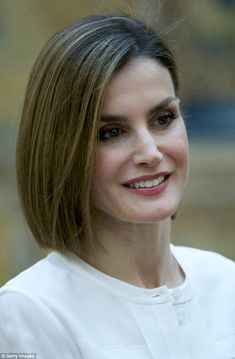 Queen Letizia styles her blunt bob into a side parting while attending a formal event in Madrid, Spain