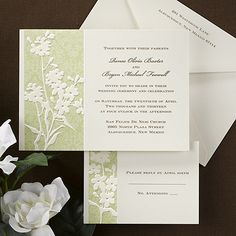 An ecru invitation card features a green, paisley design with embossed ecru flowers to the left with your wording printed to the left.