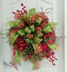 CURLY-Q method deco mesh wreath with HUGH bow and berries. Simple but enough to jazz up your door for the holidays. www.Facebook.com/zsazsacraza