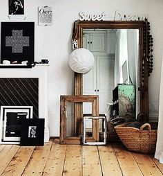 Large freestanding leaner mirror complemented by antique frames
