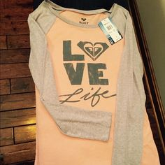 """Roxy Super Soft """"Love Life."""" Long Sleeve Top New with tags. Peach and grey long sleeve top by Roxy. Logo says """"Love Life.""""  The material of this shirt is so soft, you will never want to take it off!! Roxy Tops Tees - Long Sleeve"""