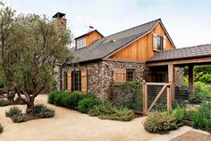 This charming New England stone farmhouse was designed by Ward Jewell Architect, located in Brentwood, California.