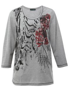 Roses brighten zebra motifs on a tunic with scoop neckline and long sleeves... - 5PNTSzmi