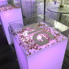 Infinity display highboy table | Shag Carpet Prop Rentals | Dallas, TX