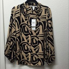 "DVF printed blouse Silk! Tag says Size 8, print is ""small lens flicker beige,"" style #S8438306L9... will fit Size S to M loosely. Purchased from Nordstrom, never worn! Diane von Furstenberg Tops Blouses"