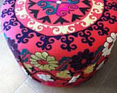 Beautiful round ottoman made from antique suzani fabric from turkey, hand embroidered.