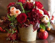 Designed by Florali. Rich reds softened by peach tones--tiny wild grapes