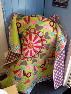 This is such a colorful, cheerful quilt. Something a teenage girl might like.