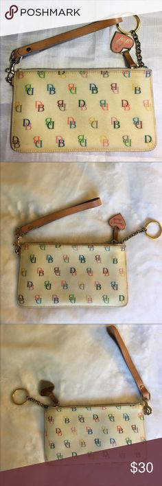 Dooney & Burke Wristlet This is a gently used wristlet. Great as a  wristlet or wallet Dooney & Bourke Bags Clutches & Wristlets