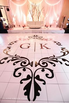 East indian wedding wedding reception tall centrepiece edmonton wedding planner wedding dance floor decal