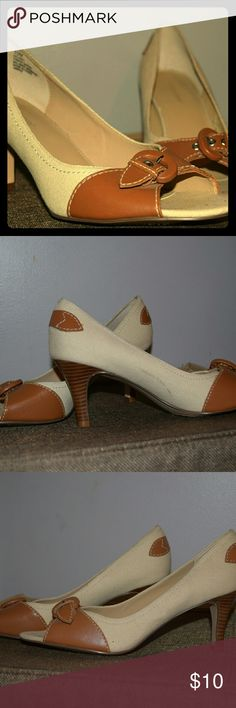 """Cream Heels Cream, canvas-like material heels with light brown leather toe & buckle. Excellent condition except for the black mark on back (pictured). Otherwise they are like brand new. 2.5"""" heel. Great for work or whatever you like! Worthington Shoes Heels"""