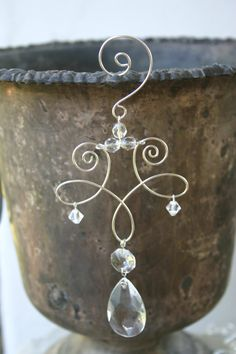 This listing is for one beautiful crystal ornament. Each ornament is handmade from a crystal pendant and silver colored wire and adorned with Swarovski crystals. Because of the nature of a handmade item, each ornament is a unique creation in itself. Size is approximately 4 x 4 with a 1 hook at top. Ornaments are sold as a singular ornament by itself.  Ornaments are available as the angel, heart, or scroll designs. Please specify when ordering. We are happy to offer shipping discounts on…