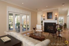 Fireplace divides living room from dining room on this home addition in Fairfax, VA Sun Designs, Remodels, Custom Homes, Home Remodeling, Divider, Dining Room, Windows, House, Home Decor