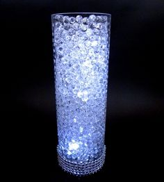 Water beads with lights, something like this with branches sticking out and flowers (plum) all around.