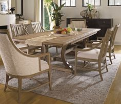 The classic form of the trestle table easily evokes lazy summer days by the water in our Shelter Bay Table. Built with family gatherings in mind  the table has two breadboard end leaves that increase the seating space to hold 10. It is easy to picture relaxed nights with friends or family around this table  where every day begins to feel like a vacation.