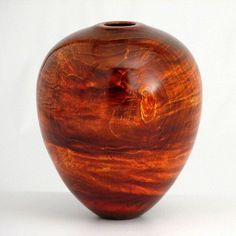 "Joe Landon - ""Summer Dream""  Hollow form vessel turned from end grain, fiddle back maple. It measures approximately 6.5 inches tall by 5 inches wide. It is finished with aniline dyes and wipe-on poly."