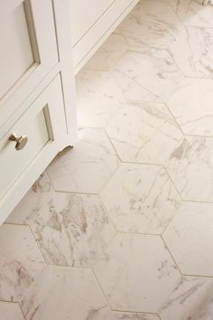 Gorgeous White Hexagon Bathroom Tile Design Ideas Hexagon tiles are often used to cover the bathroom floor because the tiles are very durable, waterproof and hex tiles can easily make cool statements. The most popular idea here is to decorate the … Bathroom Tile Designs, Bathroom Floor Tiles, Bathroom Renos, Small Bathroom, Bathroom Marble, Master Bathroom, Bathroom Tile Colors, Bathroom Tile Patterns, Tile Floor Patterns