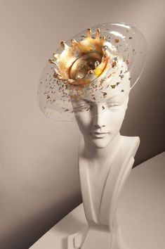 "Stephen Jones's Royal Ascot hats - ""The Spa"" hat is a translucent rippled resin splash boater, gilded with precious metals"""