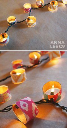 Knip wc rol stukje, kleurtje er op, met perforator gaatje maken en op kerstlampje prikken.