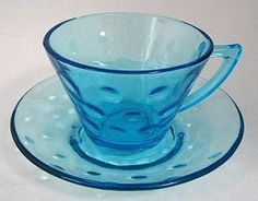This is a lovely depression glass cup and saucer in the Colonial Dots pattern in Capri Blue made by Hazel Ware, a division of Hazel Atlas Glass, USA in the 1960s .