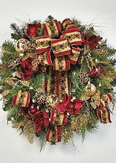 Deck your halls with the beautiful Plaza Pre-decorated Wreath that boasts a variety of ornaments, ribbon and lifelike greenery.