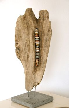 Driftwood and beach stones sculpture