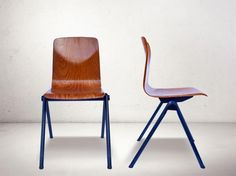 This set of four chairs was made by Galvanitas using Pagholz technology for the seats. The chairs feature powder coated steel frames in dark blue.