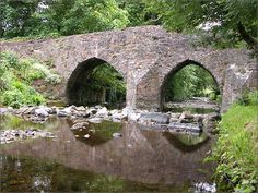 MONKS BRIDGE - RUSHEN ABBEY   ONE OF THE FEW SURVIVING PACK-HORSE BRIDGES IN THE   BRITISH ISLES - BUILT CIRCA 1350 BY THE MONKS OF RUSHEN ABBEY