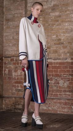 Asymetric high neck jersey jumper by Jamie Wei Huang. The Vogue Edit.