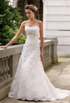 David Tutera for Mon Cheri. Romantic, strapless, lace and tulle wedding dress. A-line, empire waist, with floor length hemline.