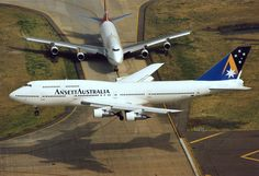 Ansett Australia 747 comes in for landing while another waits for his takeoff slot.