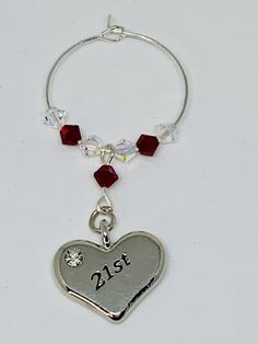 Garnet Wine Glass Charm - set with a silver plated heart engraved with - finished with Garnet and Clear Swarovski Crystals Garnet is the birthstone for January Wine Glass Charms, Organza Bags, Birthstones, Garnet, Silver Plate, Swarovski Crystals, January, Bubbles, 21st