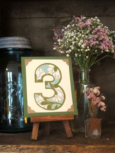 Tiny art easel for table numbers