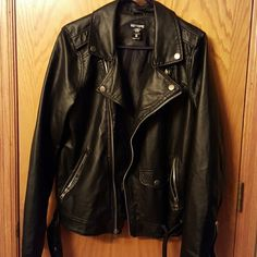 Black leather jacket Really nice Black biker jacket worn by a woman. Lady size. Worn twice.  Zip up semi middle with two side zip pockets and one breast pocket. Belt on bottom. Brand new condition Hot Topic Jackets & Coats