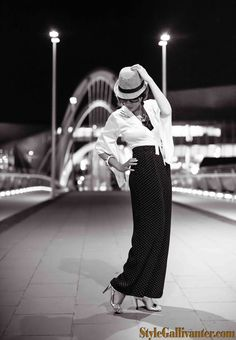 on the blog: Oriental Street Cred black and white editorials, fashion trends, trilby, fedora, womenswear, high waisted pants, palazzo pants, monochrome trend, white silk top